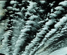 Altocumulus - bands of altocumulus clouds with cirrus filaments in the center