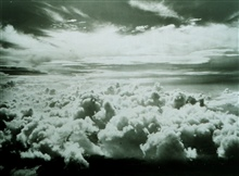An aircraft view of high cirrus and stratocumulus undercast with altostratus