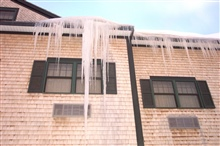 A king-sized icicle hanging from a motel roof.
