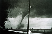 Tornado tearing up a farm field