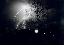Many of Mr. Lear's lightning photographs are taken from the roof of his home.He has an array of six cameras that can be activated simultaneously in order tocapture lightning images.  These six cameras span the horizon.  Mr. Lear is awelder by trade a
