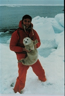 Lt. Lew Consiglieri holding a baby seal on the ice floes in the Bering Sea.Off of NOAA Ship SURVEYOR during OCSEAP Project.