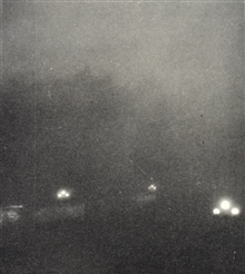 Photo # 2 of sequence.  Garden City approximately 15 minutes later after duststorm blotted out the sun.  Street lights are on allowing orientation of picture.  In:  Effect of Dust Storms on Health,  U. S. Public Health Service, ReprintNo,. 1707 from