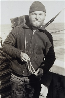 Crewman Alaskin with pet blue fox on shoulder.At shore camp off the PIONEER.