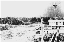 Merchant ship laboring in heavy seas as huge wave looms astern.Huge waves are common near the 100-fathom curve on the Bay of Biscay.Published in Fall 1993 issue of Mariner's Weather Log