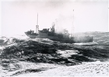 World War II North Atlantic convoy dutyMerchant vessel as seen from U.S.S. GREER (DD-145)Coming of summer was no guarantee of smooth sailing.