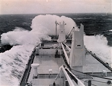 Merchantman WINTER WATER takes heavy seas on the bow from tropicalstorm Georgette.