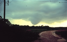 A funnel cloud approaching the ground.