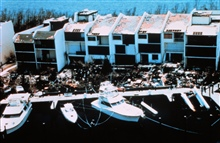 Hurricane Andrew - Kings Bay townhomes @ $750K eachDouble whammy from Andrew - upper windows blown out by winds before eyeDebris in foreground result of storm surge moving through lower levels