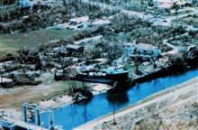 Hurricane Andrew - An ocean-going tugboat left high and dry by storm surge.Boat is on the 174th Street side of the canal.  Road in the background is oldCutler Road. A storm surge of 16.9 feet occurred a few blocks from here at theBurger King world he