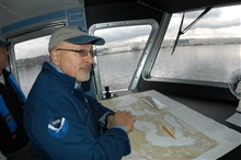 Dan Basta, director of the National Marine Sanctuary Program, standing at thechart table of the Flower Garden Banks Marine Sanctuary R/V MANTA duringshakedown cruise operations at Bellingham, Washington.