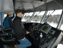 Captain Chuck Curry at the helm of the R/V MANTA during shakedownoperations near Bellingham, Washington.