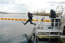 National Marine Sanctuary Director Dan Basta takes the first leap from thediving platform of the R/V MANTA in Lake Washington.  Sanctuary Director G.P.Schmahl is suited up for the second leap.