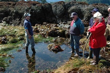 Greg McCormack,  Naturalist and Education Specialist for the OlympicCoast National Marine Sanctuary, is talking to a group of volunteerdocents about plants and animals found in tide pools.  15 miles west of PortAngeles.