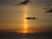 A sun pillar following the setting of the sun.