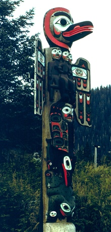 Raven and Sun Totem at Saxman Totem Park outside of Ketchikan.