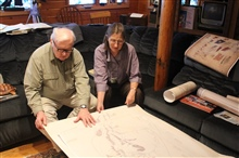 Kathy and William Ruddy, noted Alaskan historians, ethnographers, and legalauthorities, examining the Kohklux map brought by Dr. John Cloud to Alaska foruse by scholars and native corporations.  This was made possible through agrant from NOAA's Prese