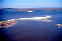 Grand Bay National Estuarine Research Reserve.Northeast over Mississippi Sound showing eroding beach on Rigolets islands. LSU aerial shoreline survey of October 1998.