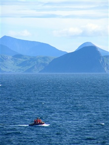 Small boat from the NOAA Ship McARTHUR II during humpback whale photo ID andbiopsy operations.  Looking to the Alaska Peninsula.