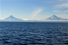 Shishaldin Volcano on the right and Isanotski Volcano on the left as seenfrom the Bering Sea side of the Aleutian Islands.