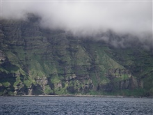 Layer upon layer of volcanic flows formed this cliff on Unimak Island.