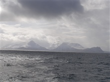 A typical Aleutian day with clouds, snow, and grey leaden sea.  Unimak Pass area.