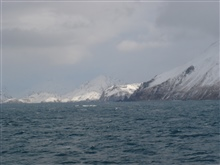 The forbidding north coast of Unalaska Island.  The stack of the SELENDANGAYU which broke apart here and sank on December 8, 2004, can be seenon the extreme right of the image.