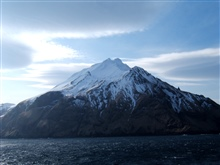 A volcanic island in the Aleutian Islands.