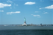 The Statue of Liberty, New York Harbor, with fair weather cumulus