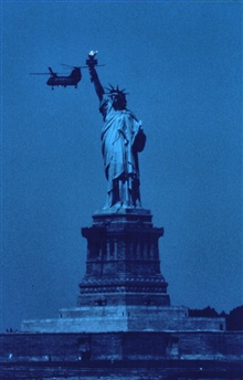 The Statue of Liberty, New York Harbor, with Navy helicopter during 1976Bicentennial Tall Ship celebration