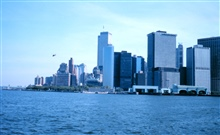 The World Trade Center and part of the New York skylineas seen from the Governor's Island Ferry.  The ferry terminals are in the rightlower center of the photo.