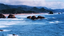 Looking south at Cannon Beach.  Haystack Rock is third from right.