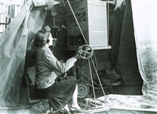 SCR-658 radio direction finder used to track radiosonde balloonsWoman observer indicates WWII or just after war time frameWorld War II expanded the opportunities for women in the Weather Bureau