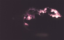 Storm clouds from night-time thunderstorm.Illuminated by cloud-to-cloud lightning.