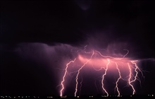 Time-lapse photography captures multiple cloud-to-ground lightning strokesduring a night-time thunderstorm.