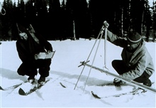 Forest Service employees measuring snow depth