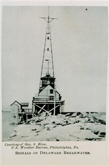 Signal Tower for Storm WarningFlags used by day, lanterns by night.  Used to warn marinersIn:  The Boy and the U.S. Weather Men, 1917, p.236