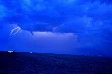 Funnel cloud and lightning