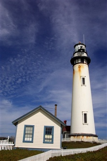 Pigeon Point Lighthouse, 27 miles north of Santa Cruz along Highway 1.  Thelighthouse was built in 1872 and is 115-feet high. Pigeon Point is named for the clipper ship CARRIER PIGEON which ran aground here on June 6, 1853.  The CoastSurvey Steamer A