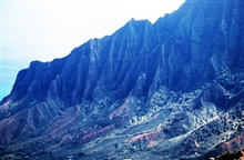 A knife-edge ridge on Kauai on the Na Pali coast.  The ridge looms over theKalalau Valley.