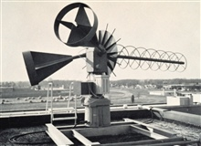 An automatic picture transmission (APT) receiving antenna mounted on the top ofthe Weather Bureau National Weather Satellite Center.   This was an eight-turn,helical, 14-foot long antenna.