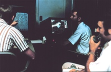NSSL researchers test new multi-moment Doppler Radar display in the late 1970's.A large complex of thunderstorms is passing near the radar.