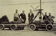 Crew with motor velocipedes and inclined level.Party of J. D. Crichton