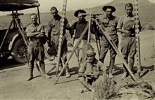 Level crew with the tools of the trade.Sub-party of H. W. Hough.Level party of H. W. Hough