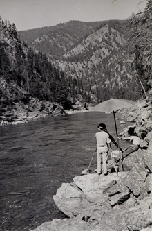 Level observations along the Salmon River.Note rod just to right of umbrella.Level party of Ira Rubottom
