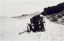 A dusty road - White 3/4 ton truck.Astro Party of C. V. Hodges
