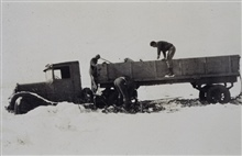 Steel tower truck stuck in the mud and snow.Triangulation party of Carl I. Aslakson