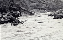 Running Snow Hole Rapids on Salmon River.Transportation for level party.Level party of Ira Rubottom.