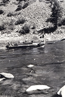 Barge with out-board motor on Salmon River.Level party of Ira Rubottom.