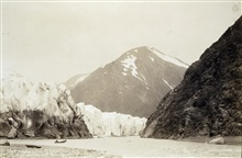 Bear Creek Canyon, Portage Glacier.Note canoe for scale of glacier.Party of R. P. Strough